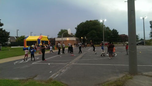 A bouncy house and action on the basketball court.